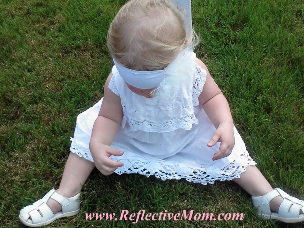 Baby with white headband.