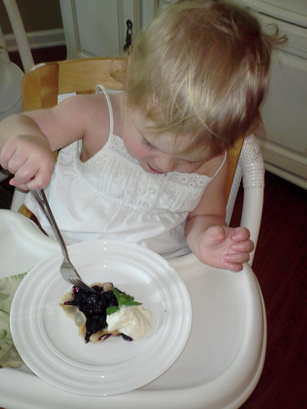 Toddler trying a Blueberry Gallette