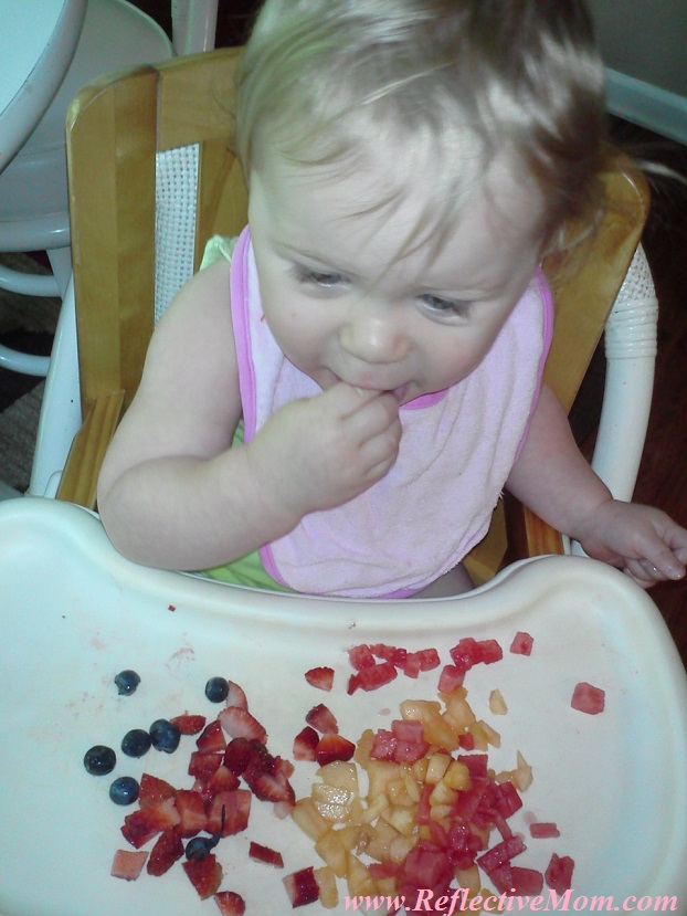 Baby Eating Fruit