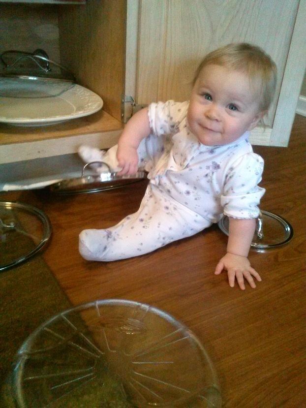 Baby in Pot Lids
