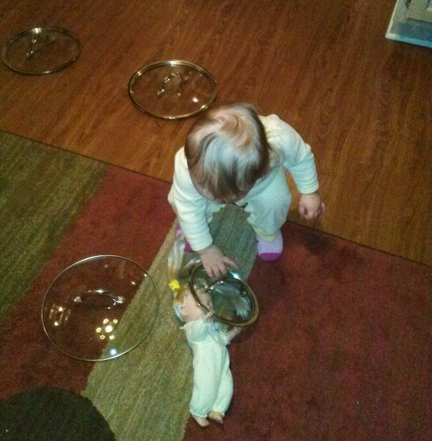 Baby Playing With Pot Lids