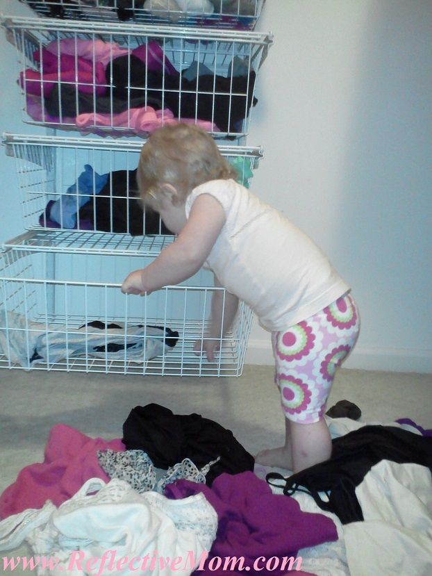 Baby Taking Clothes Out of Drawer