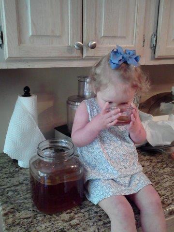 toddler drinking kombucha